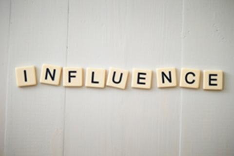 Letter tiles spell the word Influence